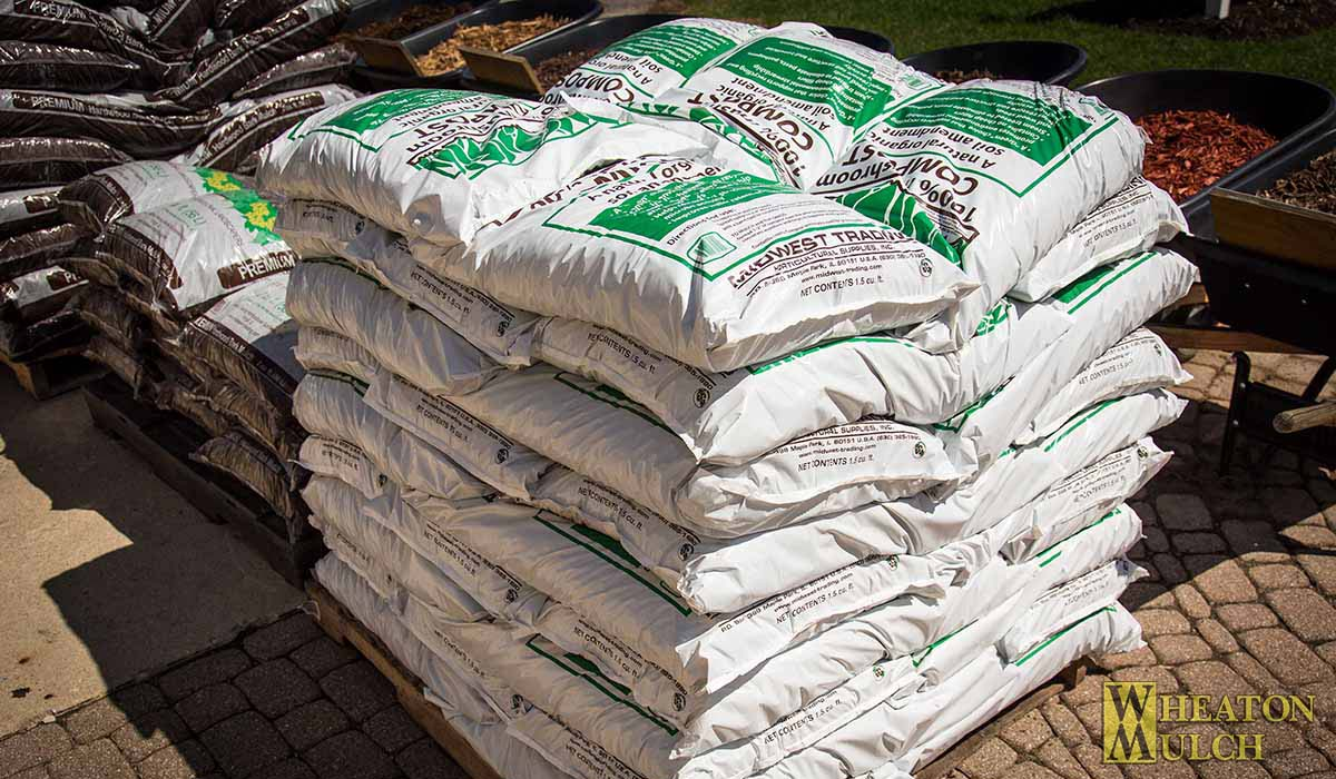 Mushroom compost 1 5 cubic feet bags wheaton mulch for Compost soil bags